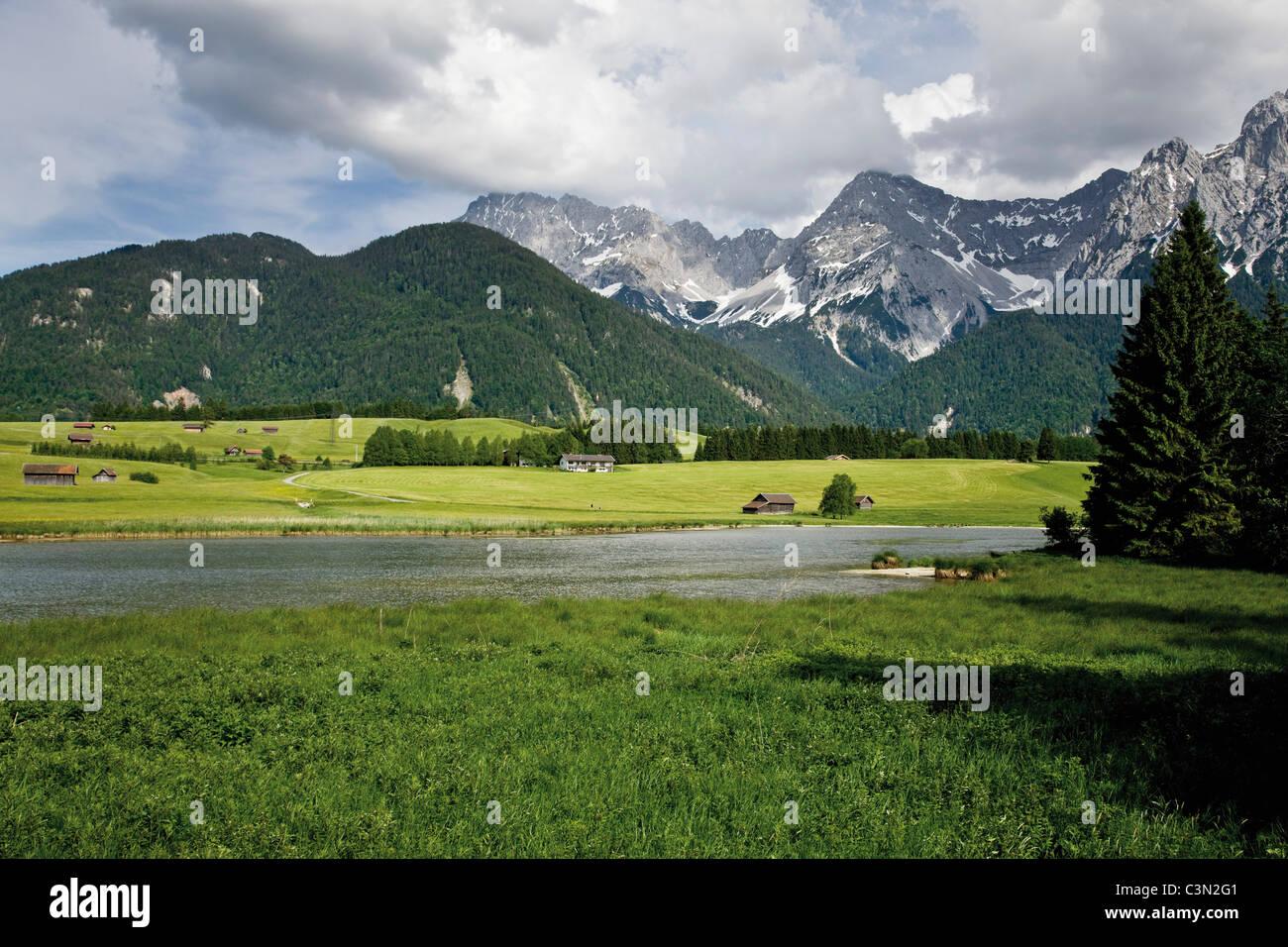 Germany, Bavaria, Lake Schmalsee with Karwendel mountains in background - Stock Image