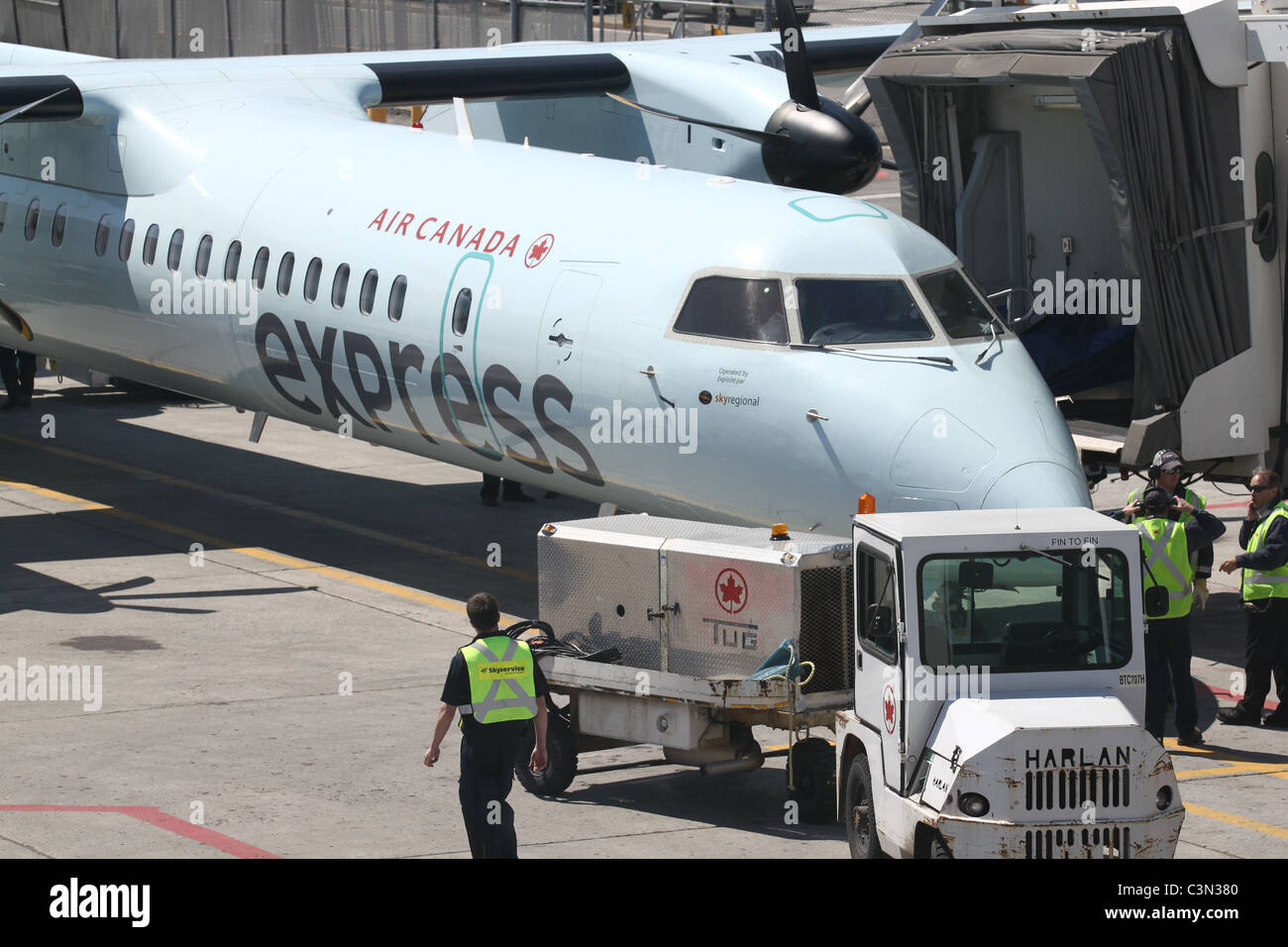 Air Canada workers prepping a plane for take-off Stock Photo
