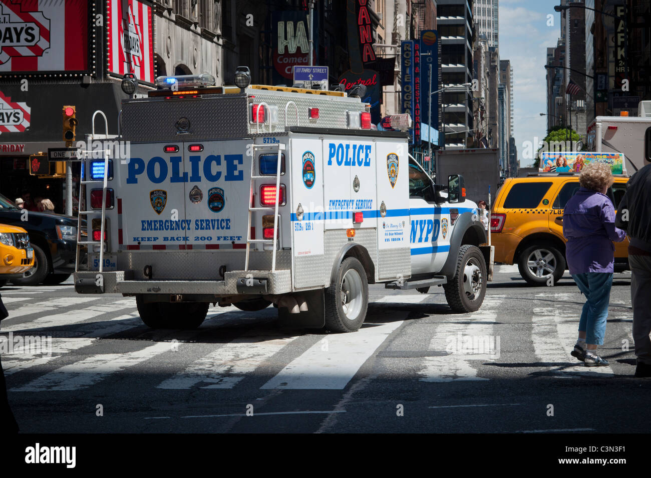 An NYPD Emergency Services Unit vehicle travels through Times Square in New  York on Tuesday,