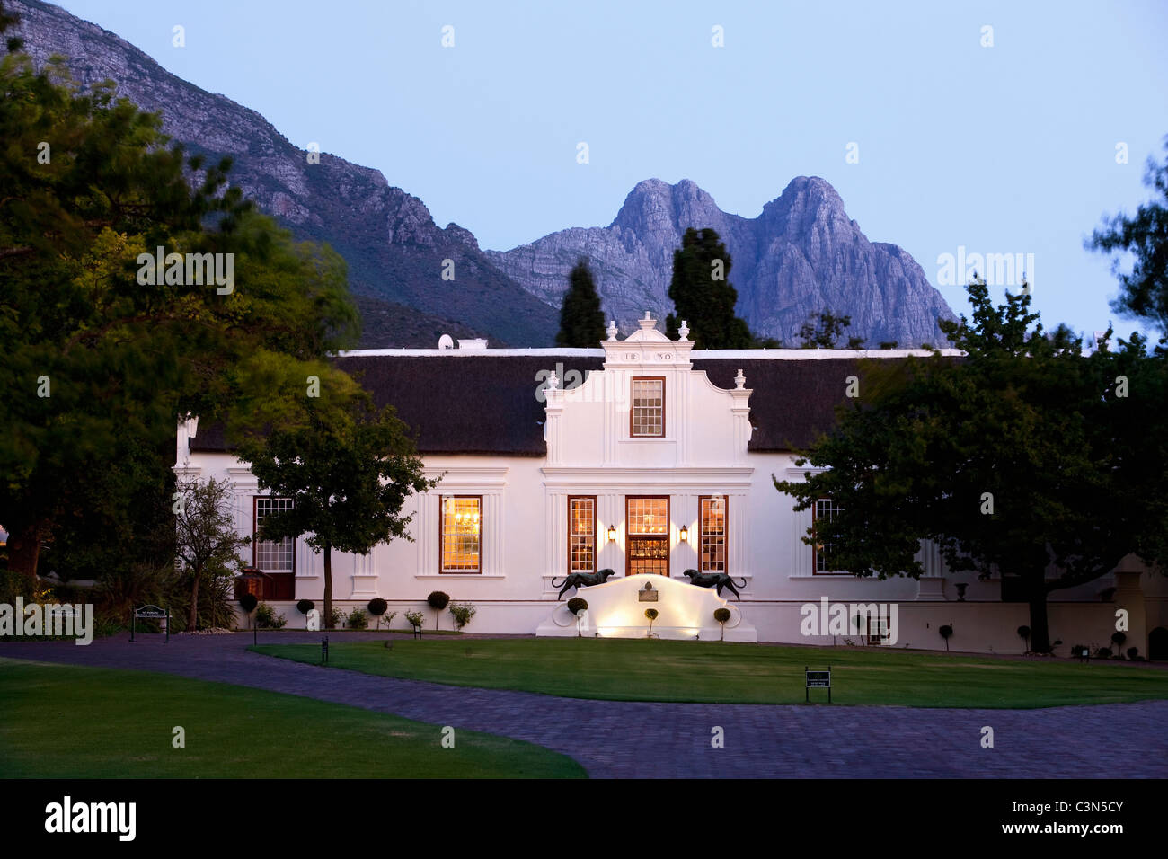 South Africa, Western Cape, Stellenbosch. Hotel and wine estate Lanzerac. Sunset. - Stock Image