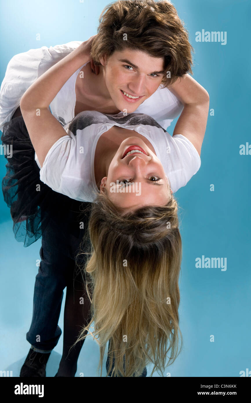 Happy young couple bend together embrac - Stock Image