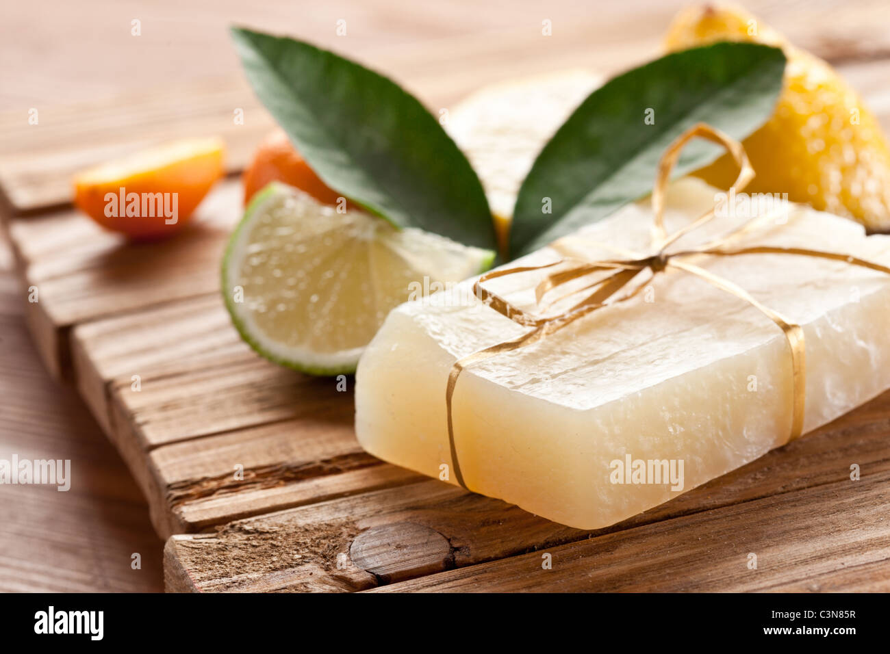 Piece of handmade lemon soap. - Stock Image