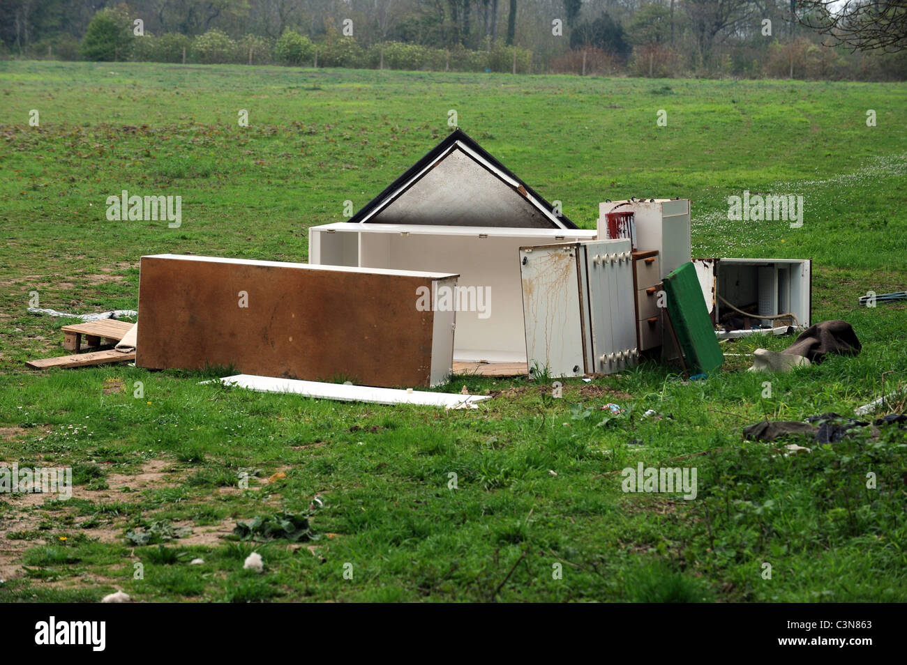 Rubbish left by travellers after they got evicted from a site in East Sussex - Stock Image