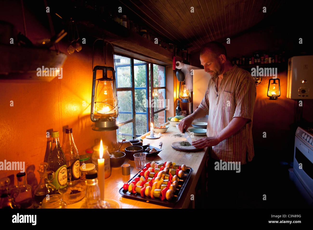 South Africa, Western Cape, Montagu, Simonskloof Mountain Retreat. Owner and host Jurgen Wohlfarter preparing food. - Stock Image
