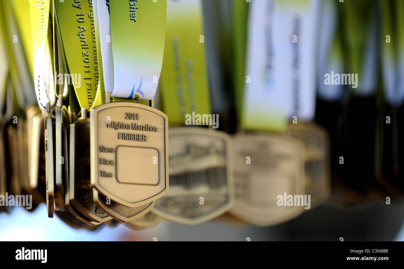 Brighton Marathon 2011 - medals for the runners at the finish line - Stock Image