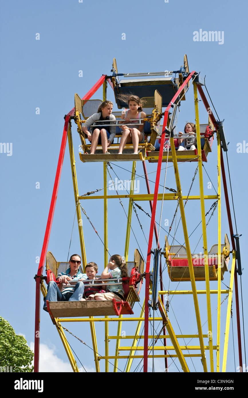 People on a big wheel ride - Stock Image