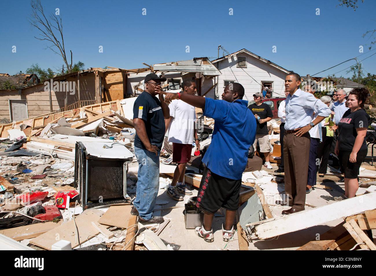 President Barack Obama and First Lady Michelle Obama inspect tornado damage in Tuscaloosa, AL, USA. - Stock Image
