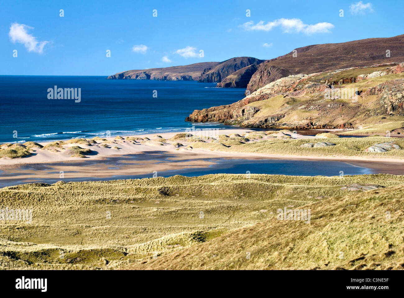 The beach and dunes of Sandwood Bay, Scotland, which can only be reached on foot from Sheigra. Taken on an almost - Stock Image