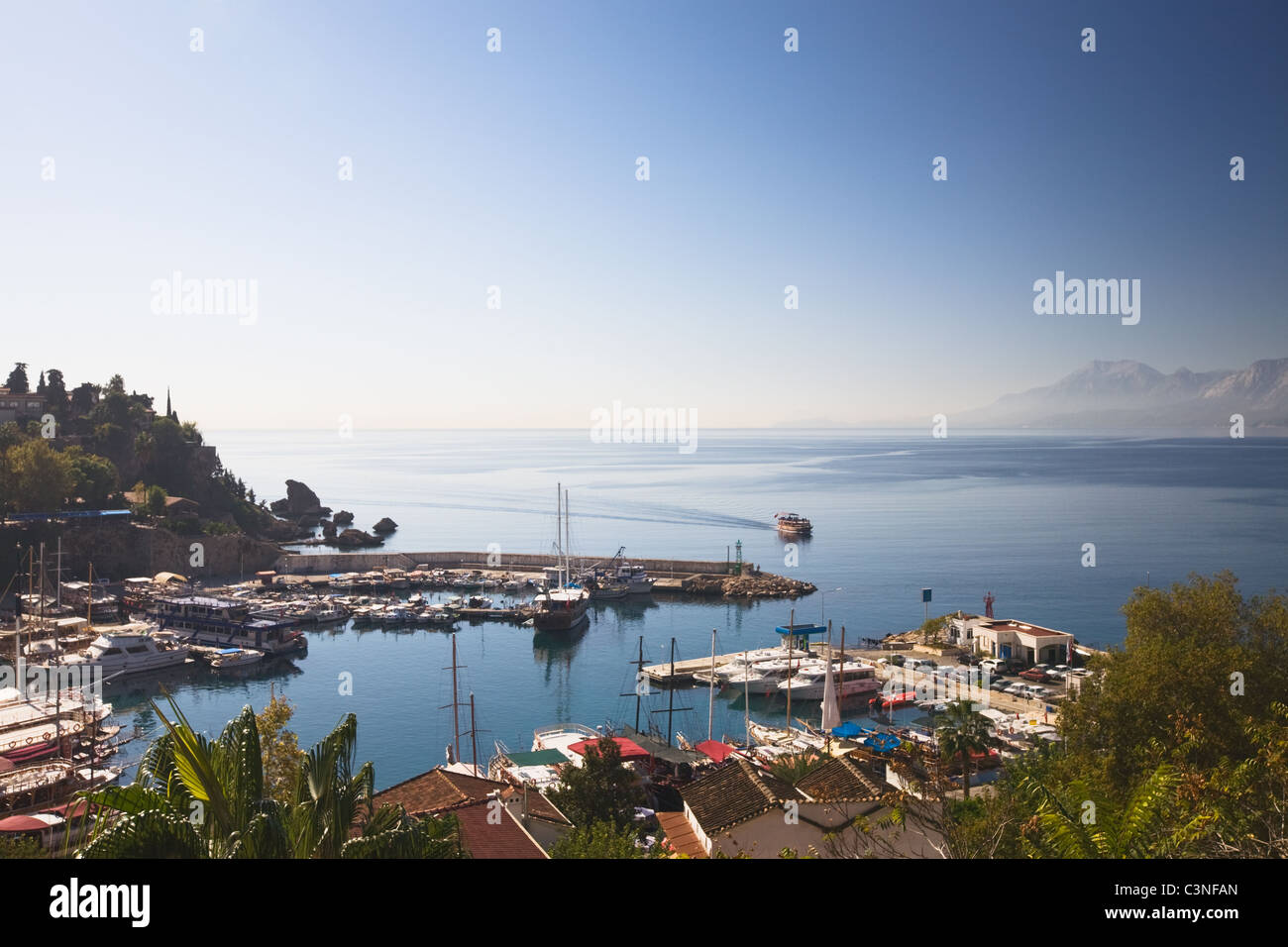 Turkey, Antalya, marina and rooftops of Old Town - Stock Image