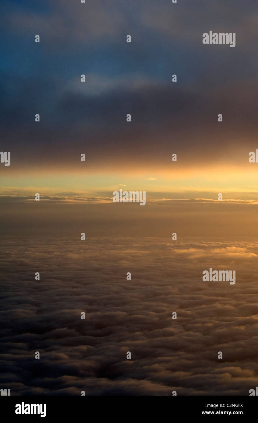 View of clouds in the sky from an airplane window - Stock Image