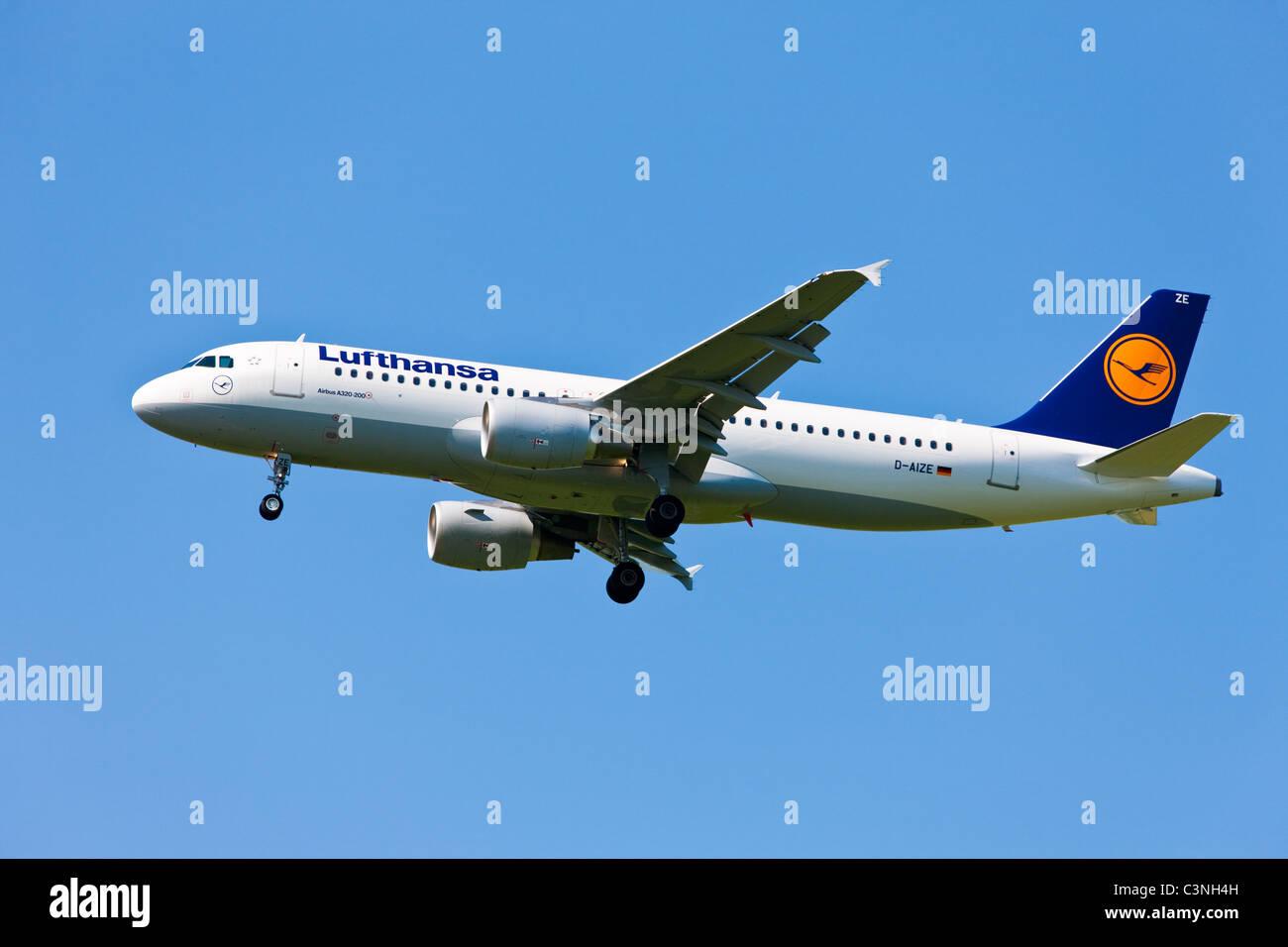 Flight Lufthansa ( Airbus A320-200 ) landing - Stock Image
