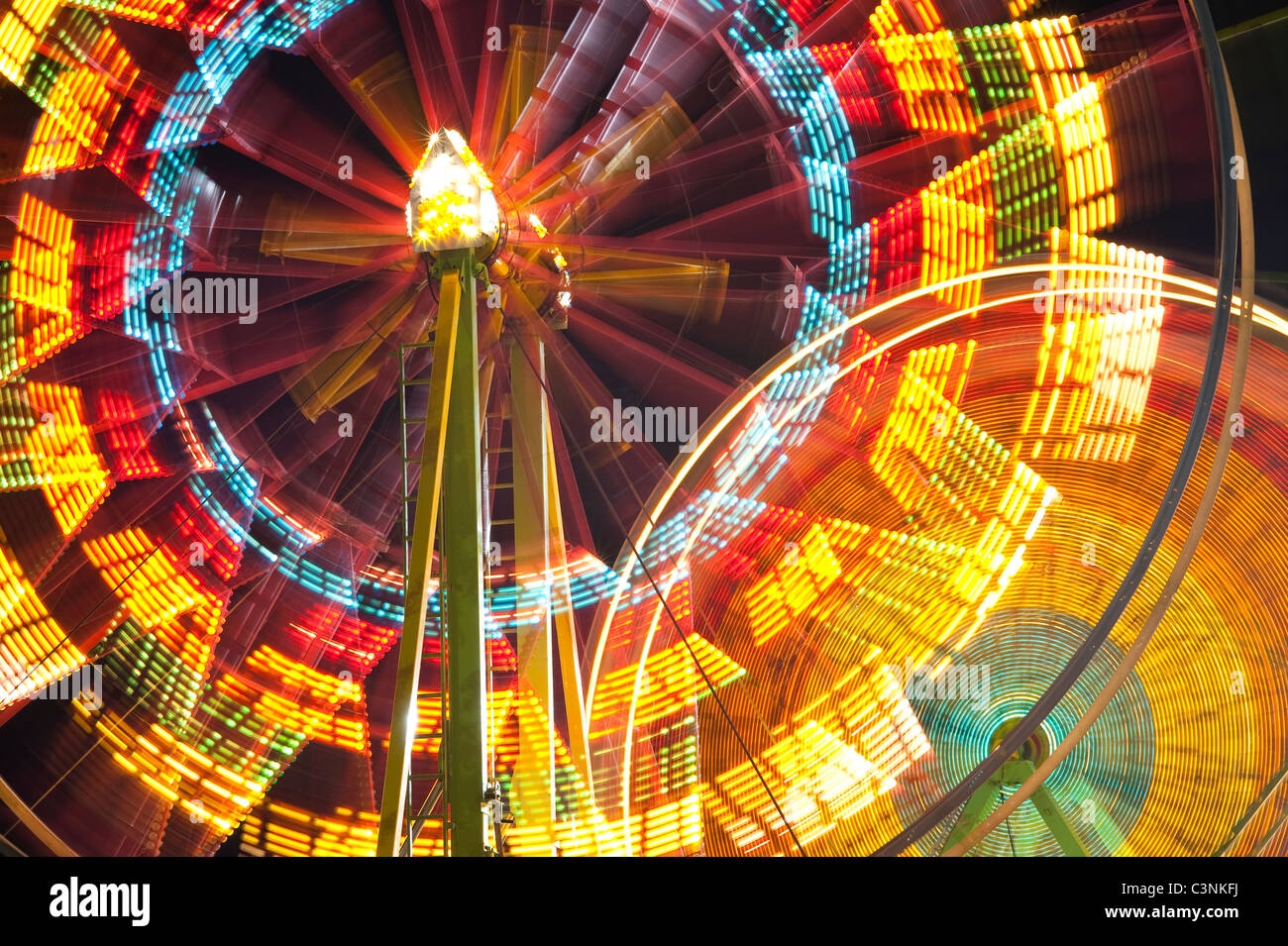 Ferris wheel in motion close up of light streaks Evergreen State Fair Monroe Washington State USA - Stock Image