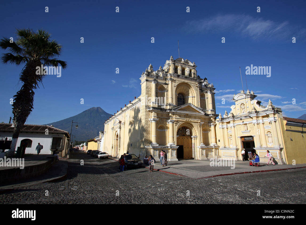 The Iglesia de Hermano Pedro with Volcan Agua in the background. Antigua Guatemala, Sacatepequez, Guatemala, Central - Stock Image