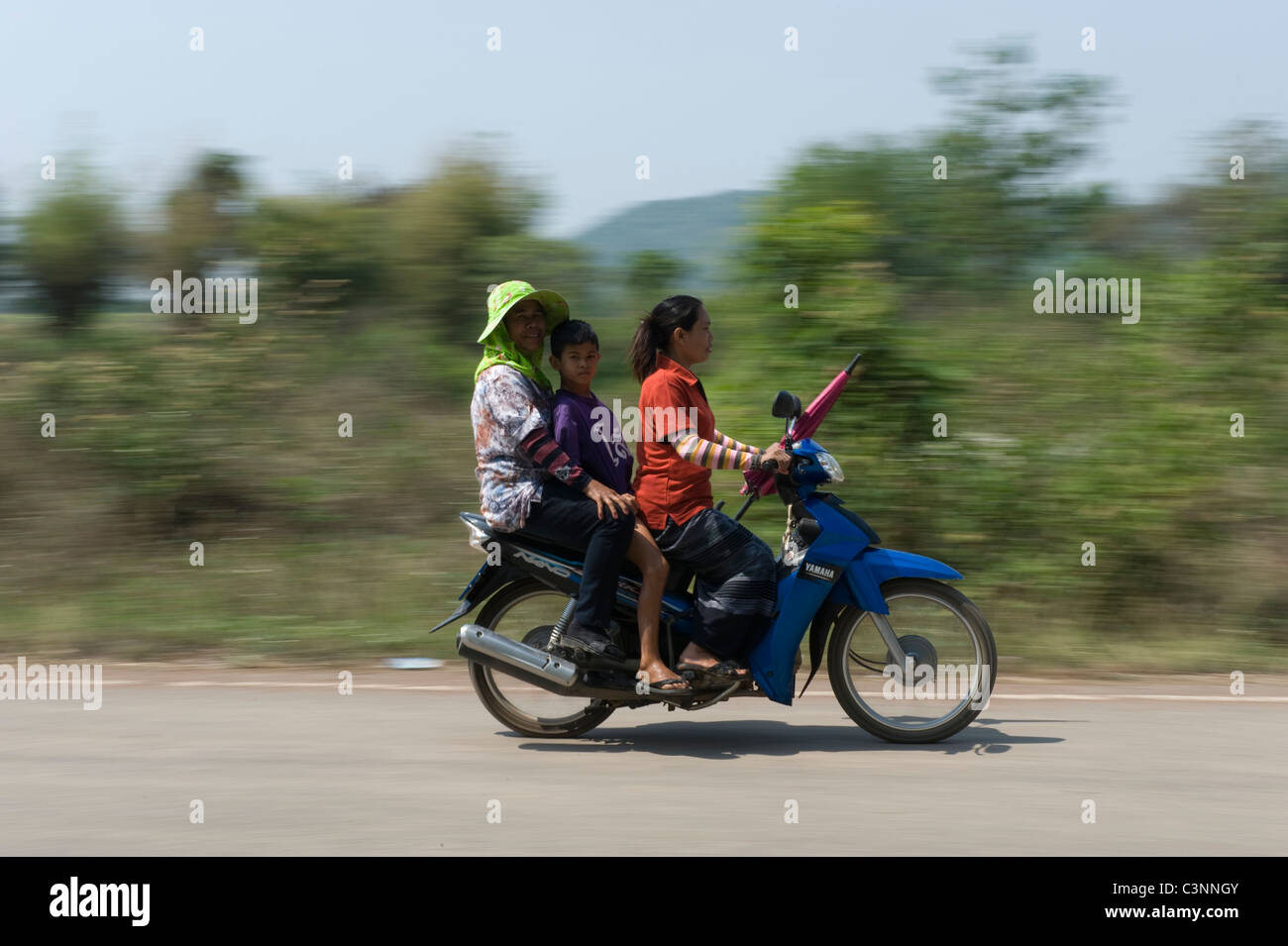 Three people on a motor cycle in North East Thailand. Stock Photo