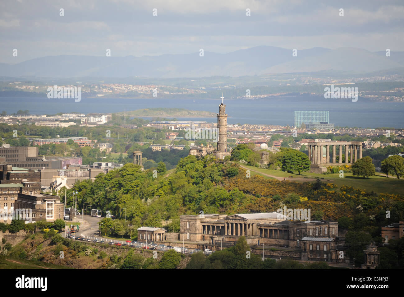 Nelson's Monument and the National Monument on Calton Hill with Royal High School bottom right and St Andrew's House Stock Photo