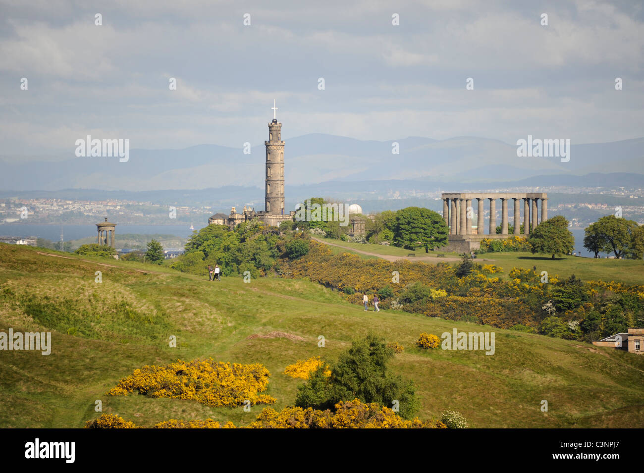 Nelson's Monument and the National Monument on Calton Hill with Salisbury Crags in the foreground in the centre Stock Photo