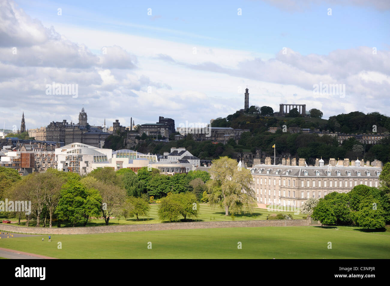 City of Edinburgh featuring the Scottish Parliament, Palace of Holyroodhouse and Calton Hill with Nelson's Monument - Stock Image