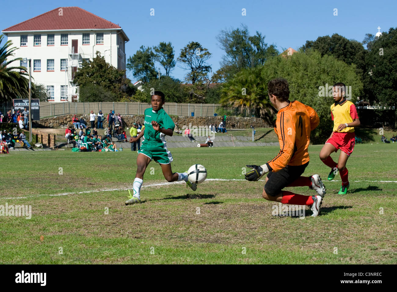 Goalkeeper and striker of an U13 football team in action Cape Town South Africa - Stock Image