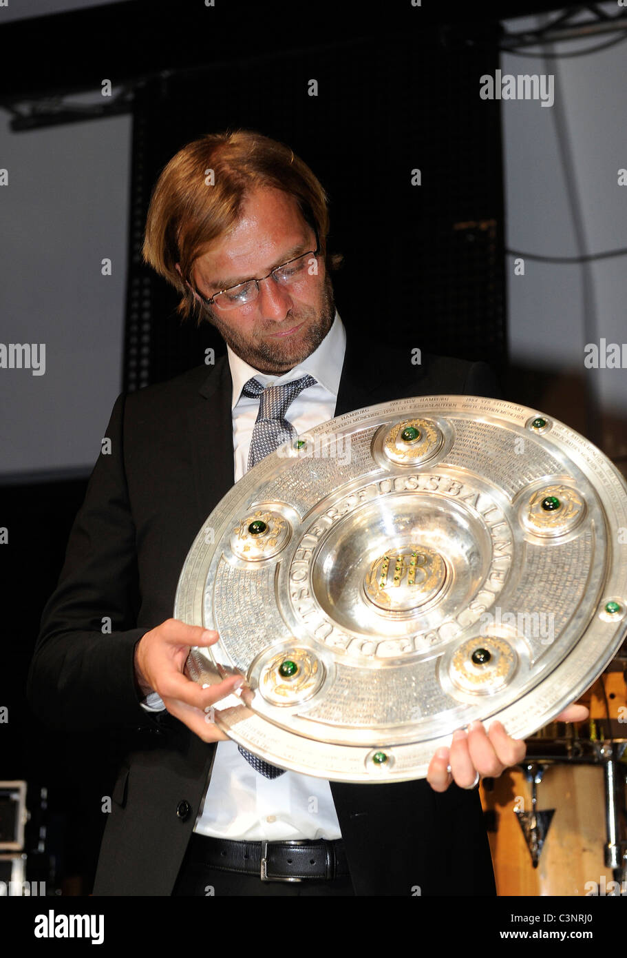 Juergen Klopp, coach of German Bundesliga club Borussia Dortmund holds the football league championship trophy - Stock Image
