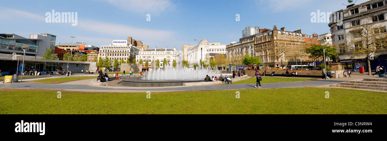 Piccadilly Gardens, Manchester with surrounding stores in background. - Stock Image