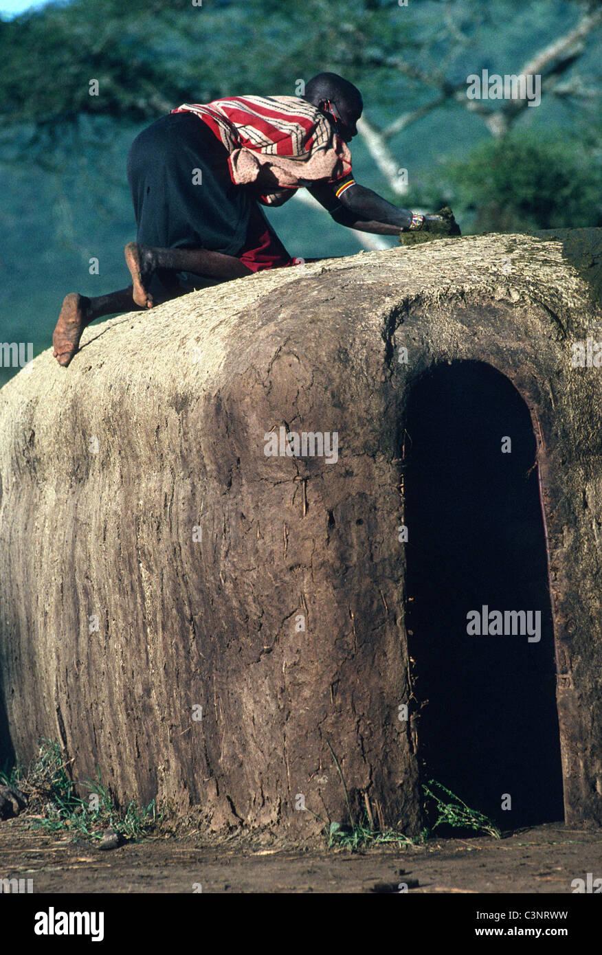 Maasai Woman Coating The Roof Of Her House With Cow Dung In. Maasai Woman Coating The Roof Of Her House With Cow Dung In Village Manyatta Kajiado Maasailand Kenya. Wiring. Diagram Of A House A Manyatta At Scoala.co