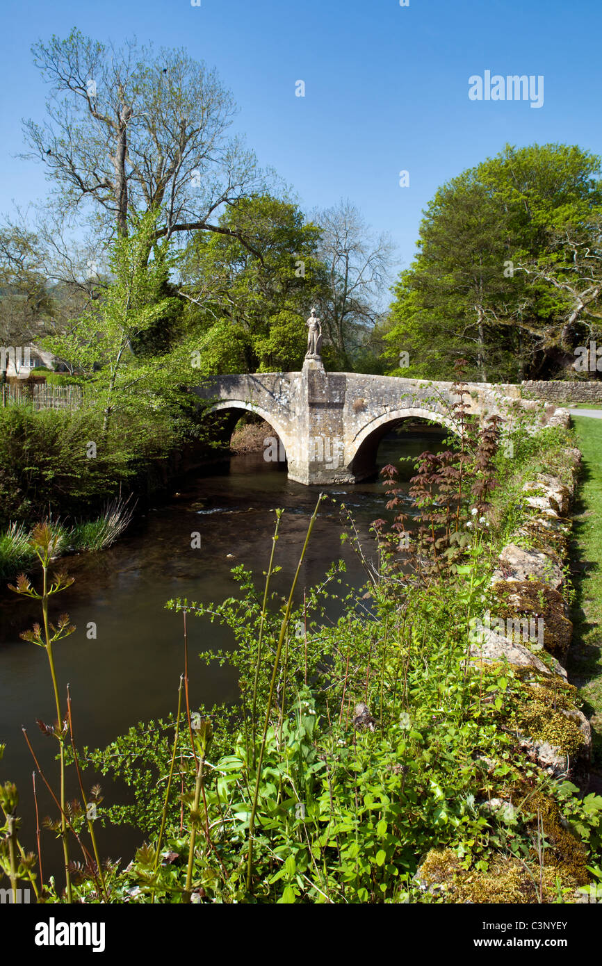Pretty road bridge and single track road at Iford, Bradford on Avon, Wiltshire, uk taken on fine spring day - Stock Image