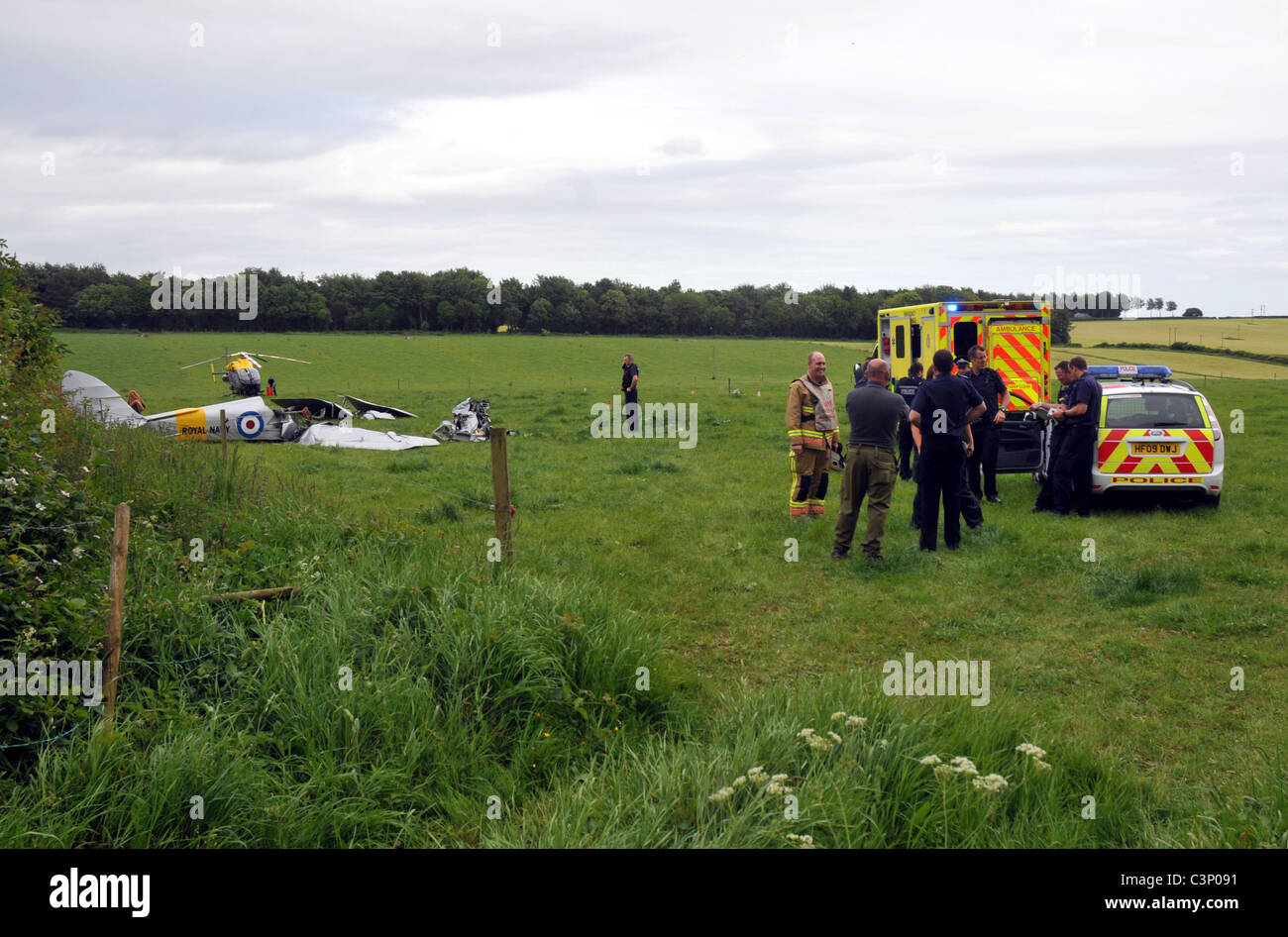 UK, Dorset, Two crew were fighting for their lives after their vintage Tiger Moth bi-plane crashed to the ground - Stock Image