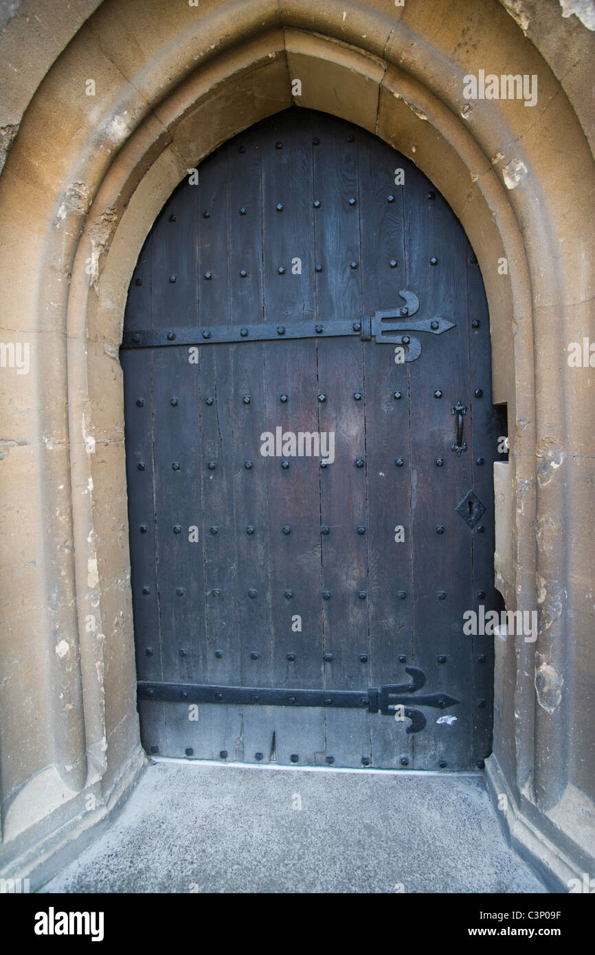 A medieval door with wrought iron hinges and studs. Gloucester Cathedral. Gloucester. England. & A medieval door with wrought iron hinges and studs. Gloucester Stock ...
