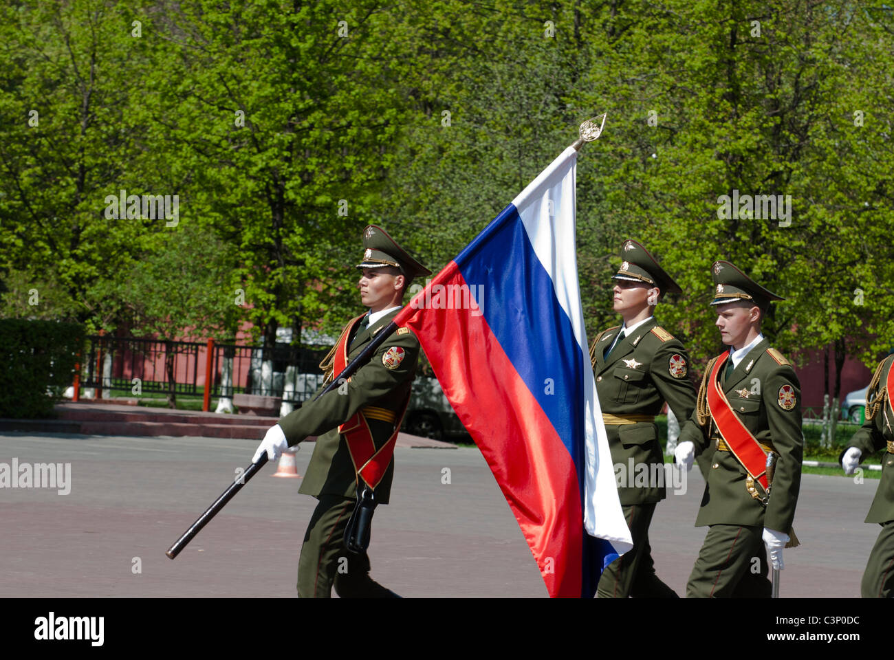 Russian soldiers with a national flag - Stock Image