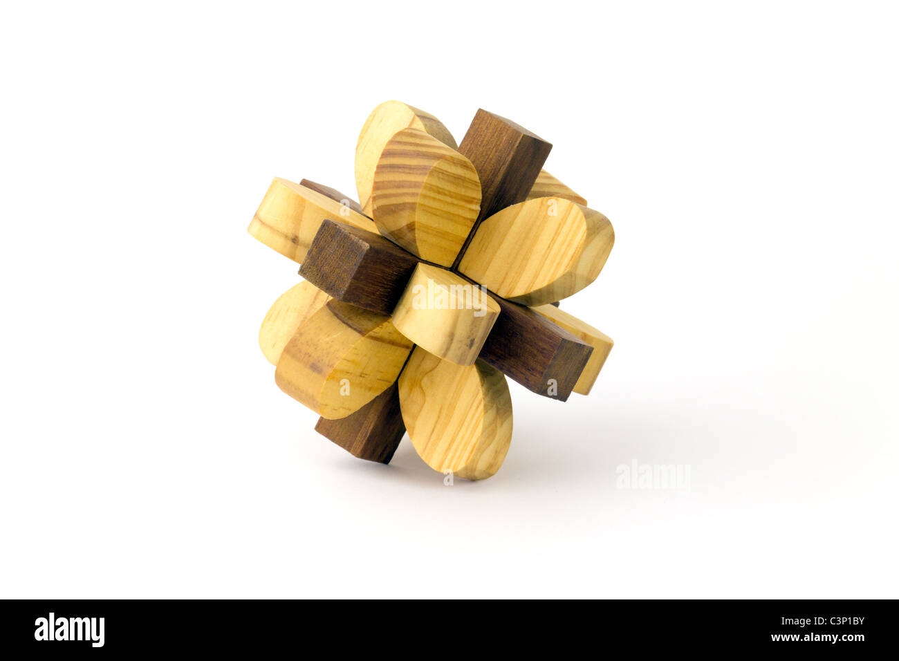 Wooden puzzle on a white background - Stock Image