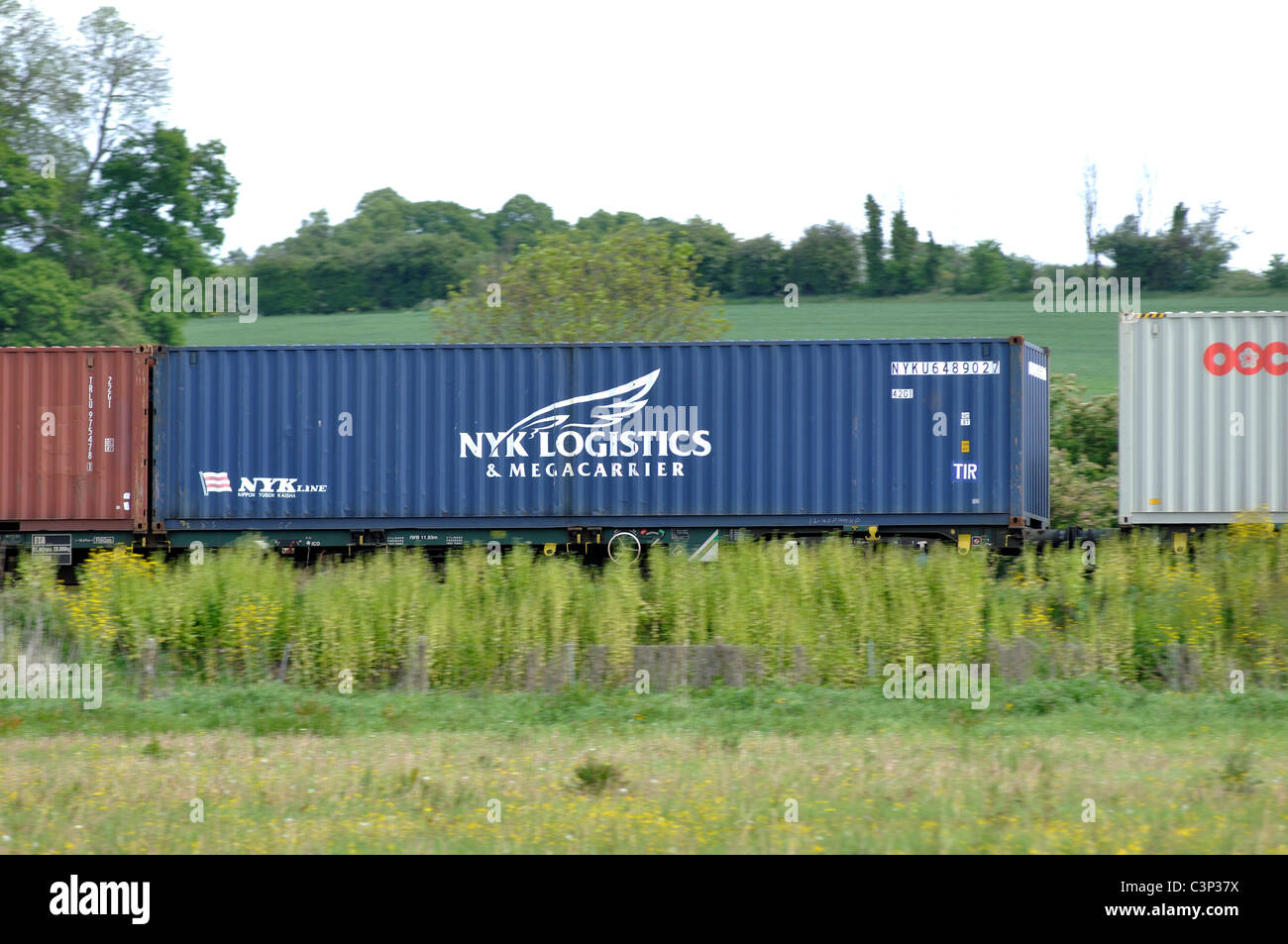 NYK Logistics shipping container transported on a train - Stock Image