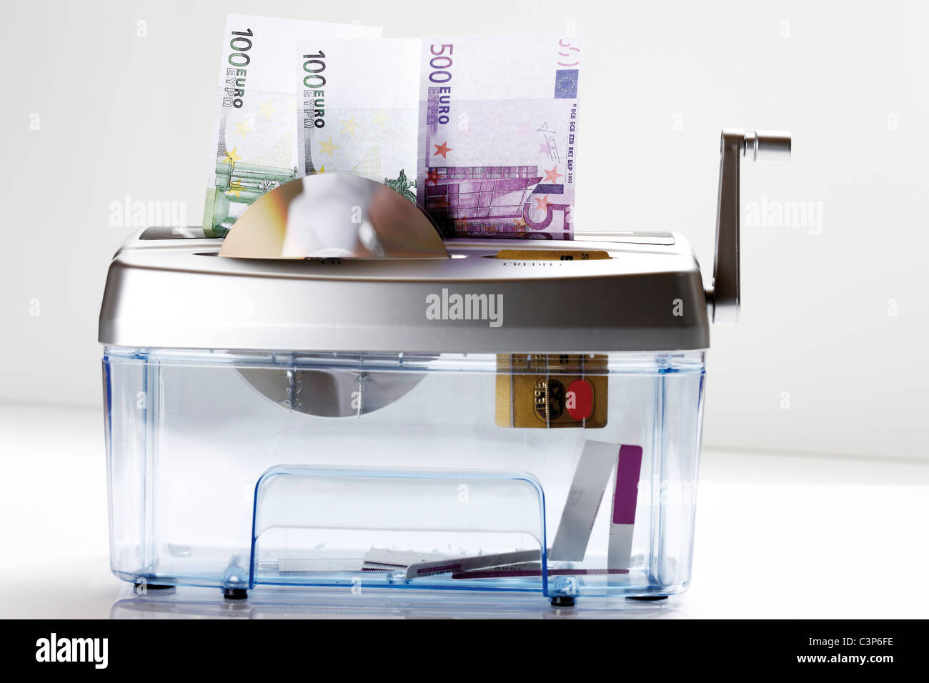 Euro notes, CD and EC-card in shredder - Stock Image