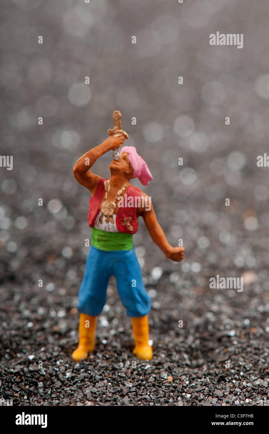 Plastic figurine, Knife eater - Stock Image