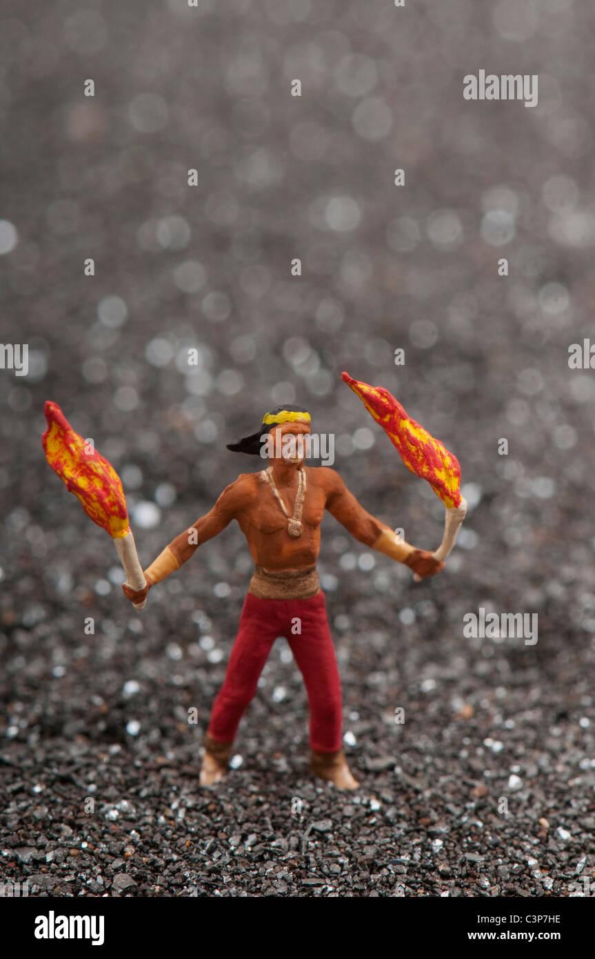 Plastic figurine, Fire eater - Stock Image