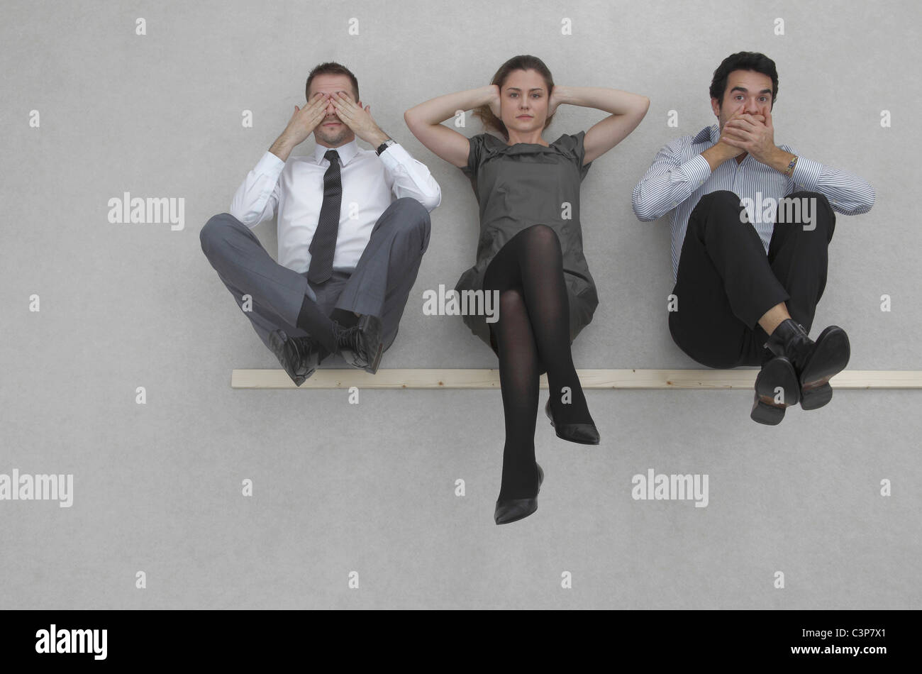Three business people, See no evil, hear no evil, and speak no evil, elevated view - Stock Image