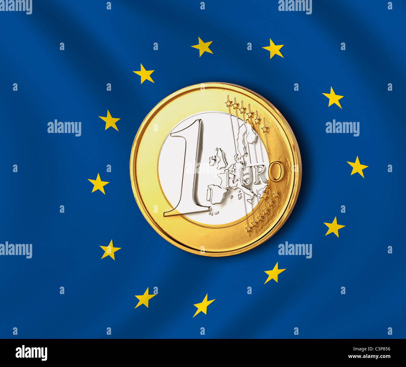 One euro coin against european union flag, close up - Stock Image