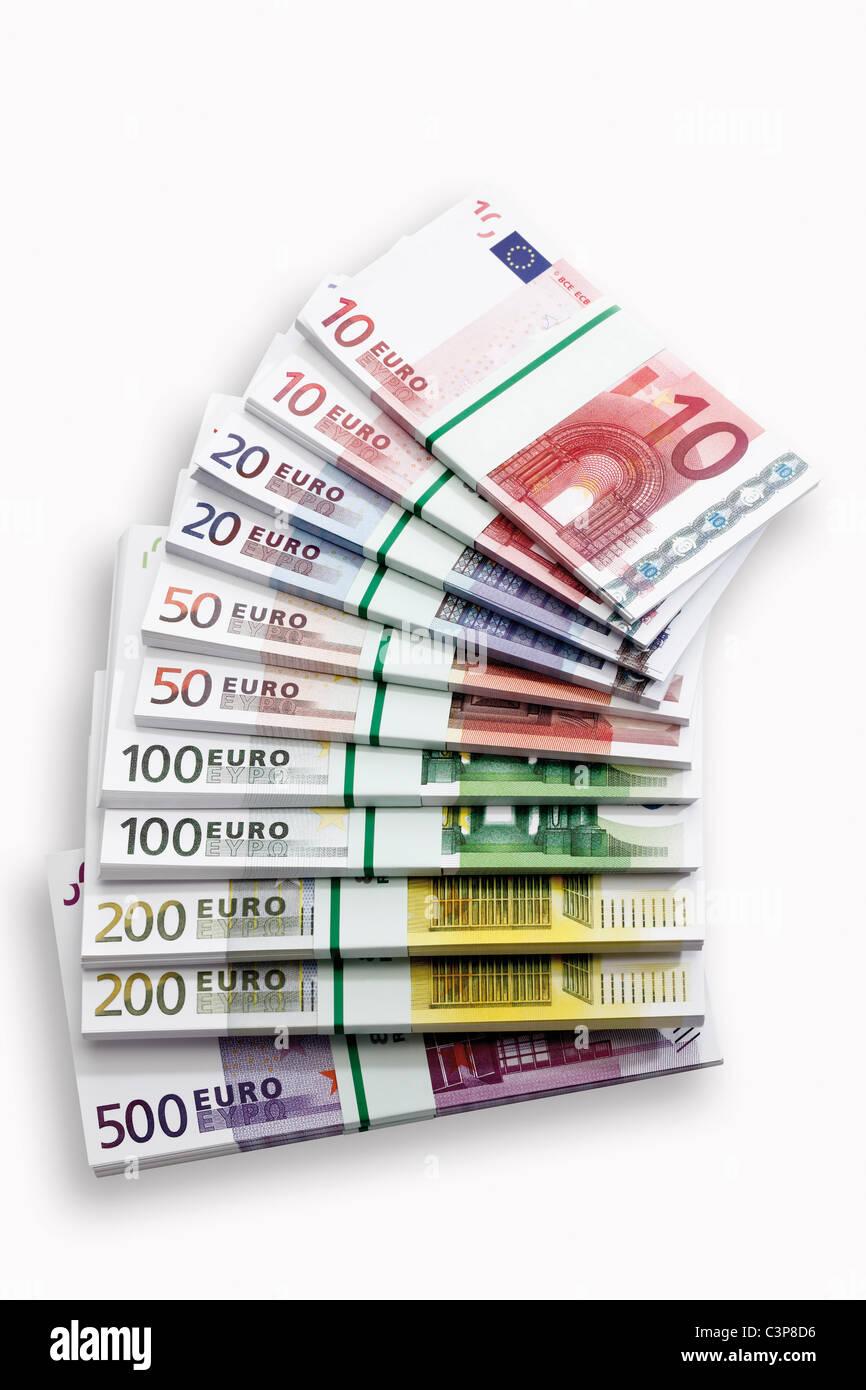 Bundles of Euro banknotes on white background, close-up - Stock Image