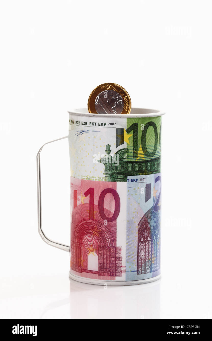 Charity can with euro coin, close-up - Stock Image