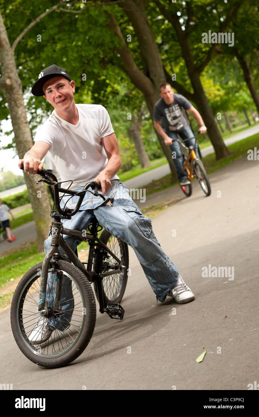 Two teenage boys with attitude on BMX stunt bikes, UK - Stock Image