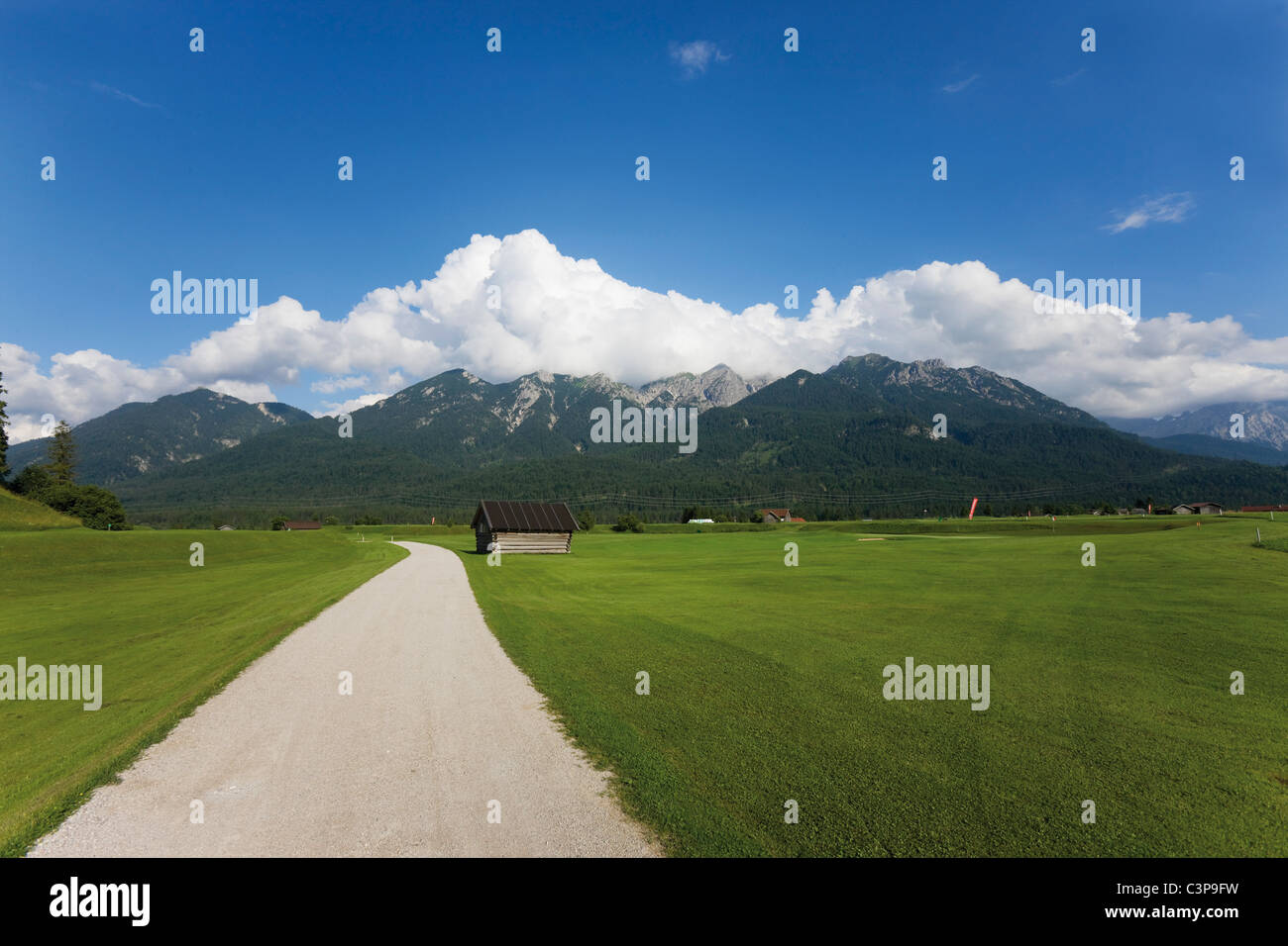 Germany, Bavaria, View of empty track with karwendel mountains in background - Stock Image
