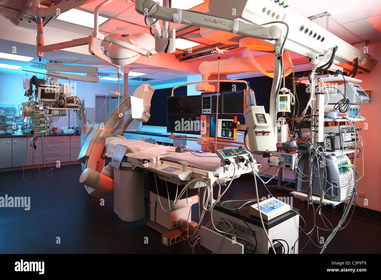 Hospital, Cardiac catheterization laboratory, (heart cath) is the insertion of a catheter into a chamber or vessel - Stock Image