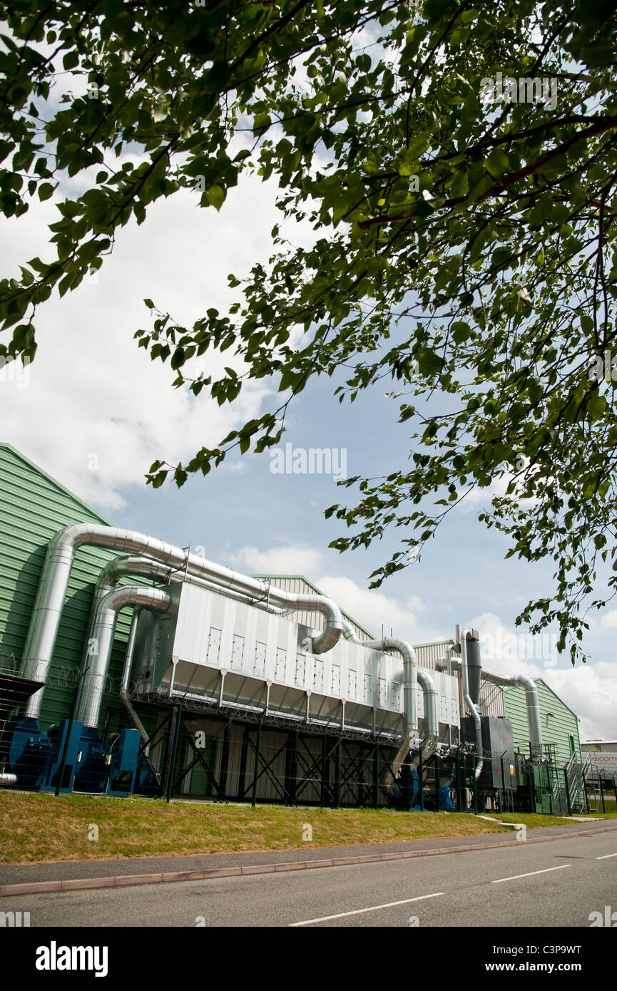 A Talbott's biomass heating and energy system using wood waste at a commercial furniture makers' factory - Stock Image