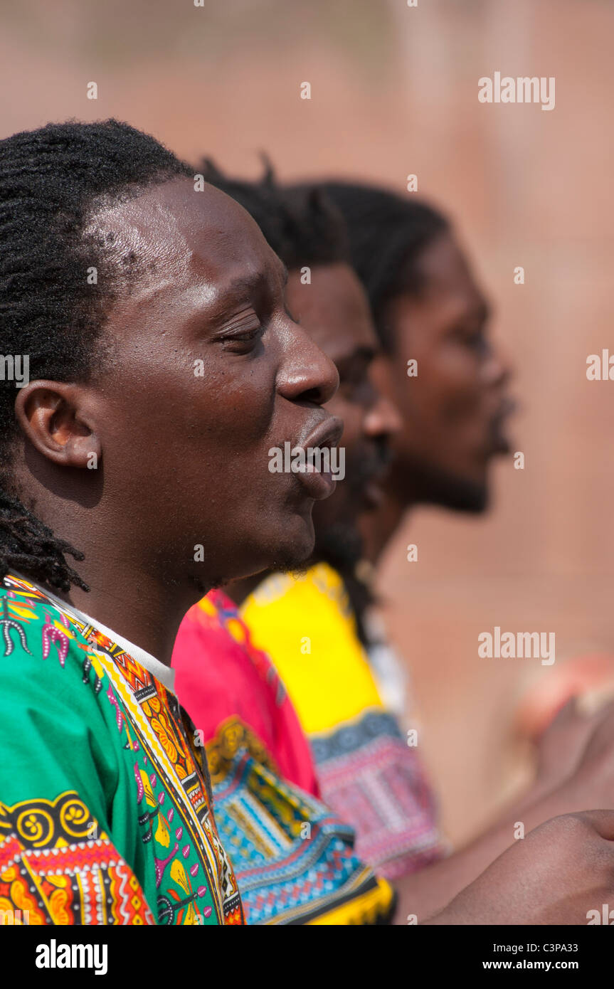 Zimbabwe entertainers singing in Chester, England. - Stock Image
