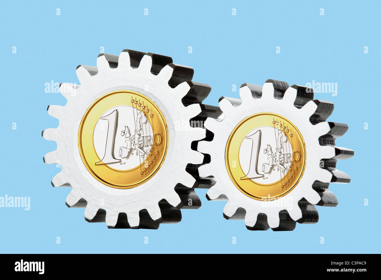 1 euro coins with cogwheels, close up - Stock Image