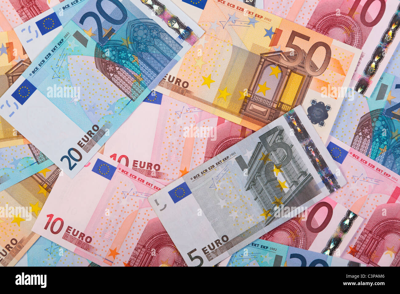 Photo of overlapping Euro banknotes in various denominations. - Stock Image
