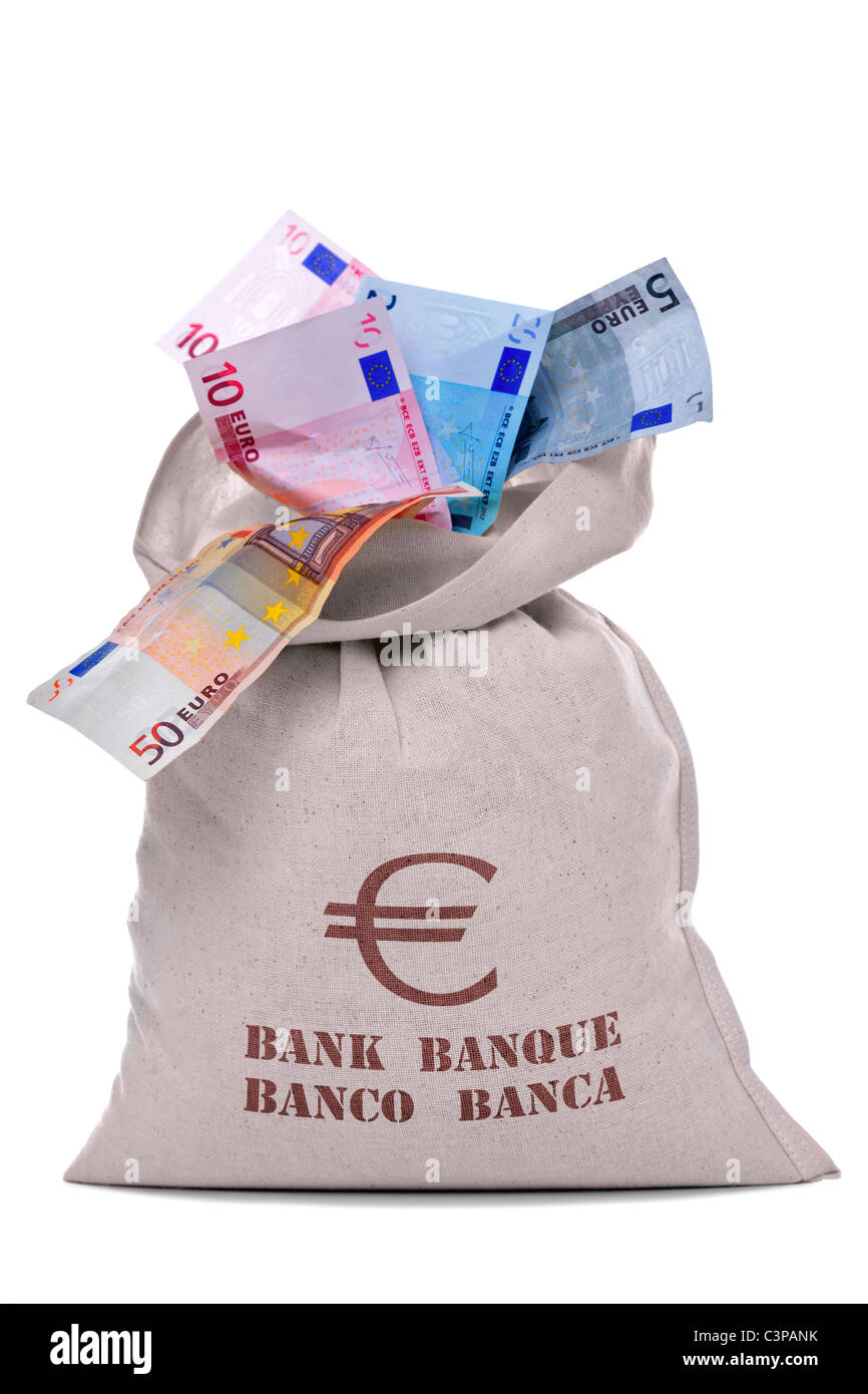 Photo of a money bag full and overflowing Euro banknotes, cut out on a white background. - Stock Image