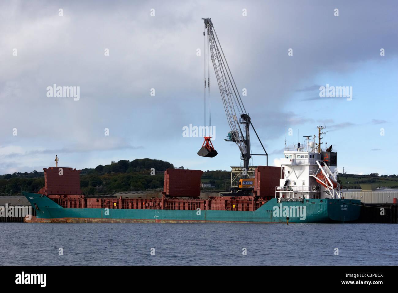 unloading power station coal from the jolanta general cargo ship at jetty at kilroot power station carrickfergus - Stock Image
