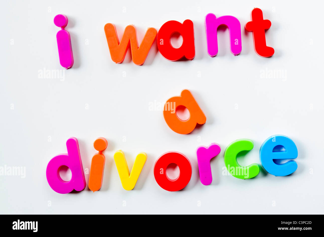 Fridge magnets magnetic letters spelling out 'I want a divorce' - Stock Image
