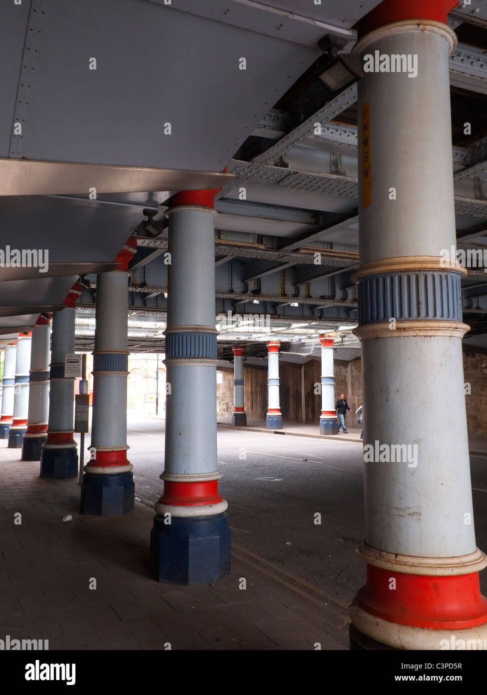 Cast iron columns supporting the Victorian Albert Bridge at Middlesbrough railway train station - Stock Image