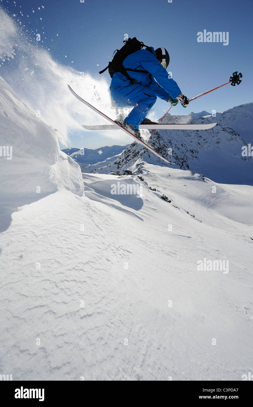 Italy, South Tyrol, Sulden, Man skiing downhill - Stock Image
